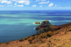 Ynys y Ddinas across Pwll Deri Pembrokeshire Coastline Stock Photo