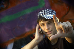 Yo, dude!. American teen(special f/x with vignetting,focus on the hand Royalty Free Stock Photo