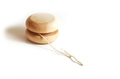 A yo-yo. A wooden isolated yo-yo Royalty Free Stock Photo