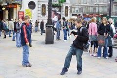 Yo-yo juggling. Boys performing yo-yo in the street of London, UK Royalty Free Stock Image
