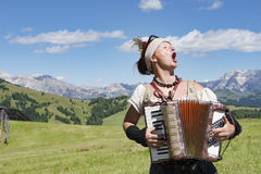 Yodeling in Alps Royalty Free Stock Image