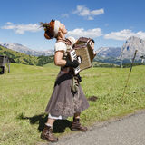 Yodeling woman playing accordion in Alps Royalty Free Stock Images