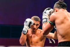 Yodsanklai Fairtex of Thailand and Kazbek Zubayraer of Rassia in Thai Fight Extreme 2013. Royalty Free Stock Image