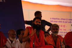 Yog guru baba Ramdev speaking on stage Stock Photography