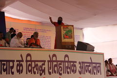 Yog guru Swami Ramdev speaking on stage Stock Image