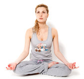 Yoga. Portrait of young sexy woman in lotus pose exercising yoga Royalty Free Stock Photos