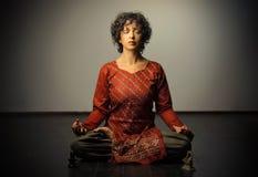 Yoga. Portrait of woman in yoga's lotus position Stock Photo