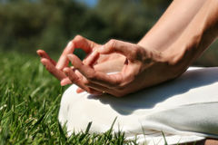 Yoga. Woman practicing Yoga outdoors...Mudra pose Royalty Free Stock Image