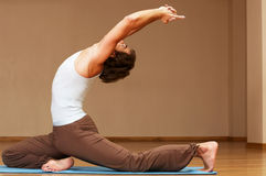 Yoga. Young man doing yoga exercise indoors Royalty Free Stock Images