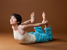Yoga. Young girl does exercise of yoga Stock Photo