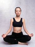 Yoga. A Chinese girl practicing yoga Royalty Free Stock Images