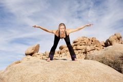 Yoga. Woman in yoga pose bowing with hands in meditation hasta mudra, outdoors Royalty Free Stock Images