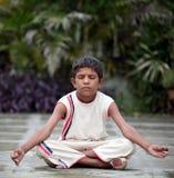Yoga. Small boy doing yoga in garden Stock Photo
