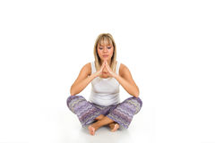 Yoga. Blond young girl wearing workout clothes. Yoga concept Royalty Free Stock Image