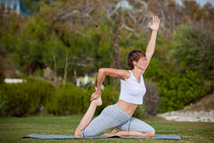 Yoga. Woman practicing yoga in park Stock Image