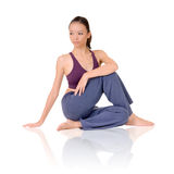 Yoga. Exercise on ground by Asian girl of fitness, full length portrait isolated on white background Stock Photos