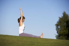 Yoga-2. Woman practicing yoga in the morning stock photography