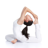 Yoga. Female asian teenager doing yoga against white background