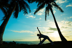 Yoga. Woman Practicing Yoga at Sunset Royalty Free Stock Image