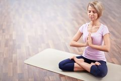 Yoga. Young girl in lotus position Royalty Free Stock Photos
