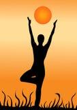 Yoga. Doing yoga at the sunset Royalty Free Stock Photo