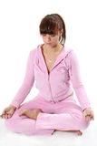 Yoga. The girl in pink clothes is engaged in yoga Stock Photo