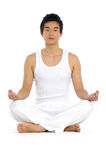 Yoga. Young Asian doing yoga in the  room Royalty Free Stock Photo