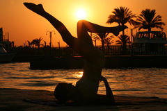 Yoga. At sunset near the ocean Royalty Free Stock Photo