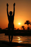 Yoga. At sunset near the ocean Royalty Free Stock Photography