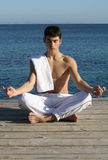 Yoga. Young man in yoga position Stock Photo