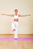 Yoga. Young woman in a yoga position royalty free stock image