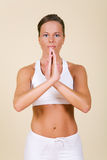 Yoga. Young woman in a yoga position royalty free stock photo