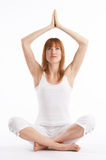 Yoga. Woman in white dress practicing Yoga exercises Royalty Free Stock Photography