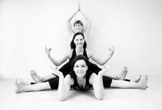 Yoga. Three young caucasian women practising  group yoga in a studio indoor Stock Photography