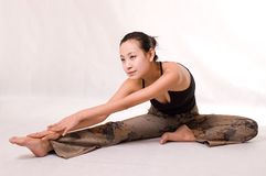Yoga. A young girl doing yoga exericise indoors Stock Photos