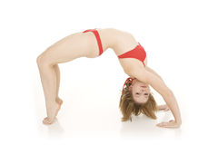 Caucasian teenager practing yoga in a red bikini isolated on a white background Royalty Free Stock Photo