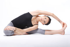 Yoga. Young yoga female doing yogatic exericise Royalty Free Stock Photo