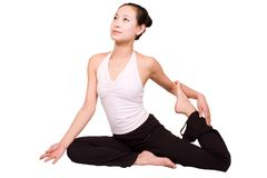 Yoga. A young girl doing yoga exericise indoors,Cutout image Royalty Free Stock Image