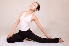 Yoga. A young girl doing yoga exericise indoors Royalty Free Stock Image