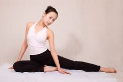 Yoga. A asian girl doing yoga exericise indoors Royalty Free Stock Photos