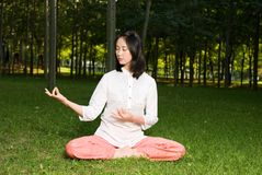 Yoga. A asian Chinese girl doing yoga exericise outdoors Stock Photography