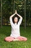 Yoga. A asian Chinese girl doing yoga exericise outdoors Stock Photos