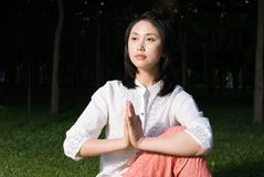 Yoga. A asian Chinese girl doing yoga exericise outdoors Royalty Free Stock Photography