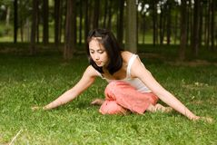 Yoga. A asian Chinese girl doing yoga exericise outdoors Royalty Free Stock Image