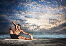 Yoga akarna dhanurasana pose Stock Images