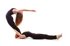 Yoga appareillé sur un fond blanc Photographie stock libre de droits