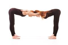 Yoga appareillé sur un fond blanc Images libres de droits