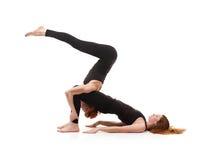 Yoga appareillé sur un fond blanc Photos libres de droits