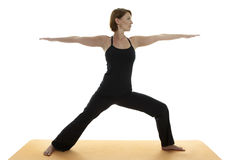 Yoga Asana. Warrior Pose in Studio stock photo