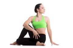 Yoga asana Ardha Matsyendrasana Royalty Free Stock Images
